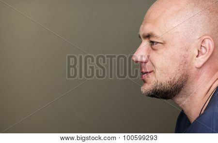 Profile portrait of bald man with copyspace poster