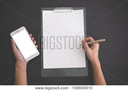 Hand Holding Pen, With A Notes And Handphone, Black Background, Mock Up