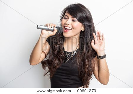 Pretty Young Asian Woman Happy Singing A Song