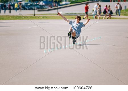 Young man roller on rollerblades driving in park in district Nem