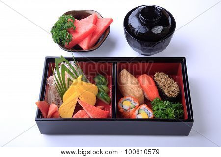 Sushi Set In Wooden Bento (japanese Lunchbox) Isolated On White Background