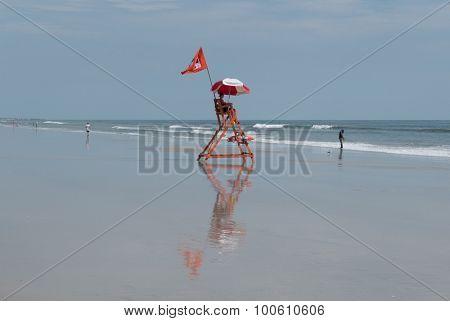 JACKSONVILLE BEACH, FL-AUGUST 28, 2015: A lifeguard watches over Jacksonville Beach, Florida. The Jacksonville Beach Lifeguards began in the summer of 1912 with a dozen volunteers.