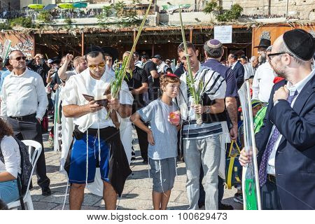 JERUSALEM, ISRAEL - OCTOBER 12, 2014: The area in front of the Western Wall of the Temple filled with people. Morning autumn Sukkot
