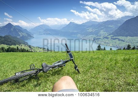 Cycler Relaxes On Top Of Lake Lucerne