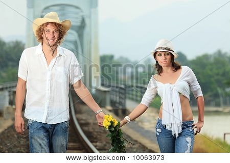 Couple On Train Tracks