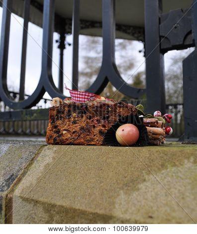 christmas cake and marzipan fruits outdoors