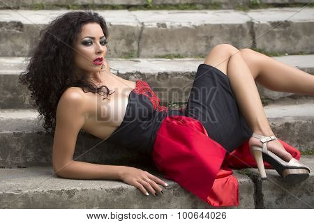 Sexual Pretty Young Large Breasted Woman Sitting On Stairs