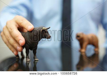 Businessman Holding Bull, Concept Of Bullish Trend On Stock Market