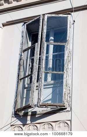 old sprout mustard ester, double window with peeling paint