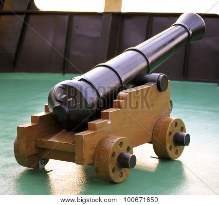 Old iron cannon on a wooden carriage poster