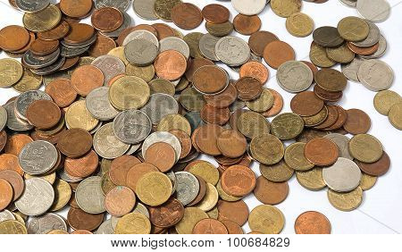 Many Of Pile Of Coins Baht Thailand Currency On White Background.