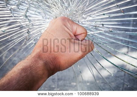 Powerful Male Fist With Broken Glass