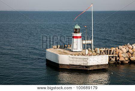 Lighthouse at the harbor entry Aero island Denmark