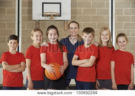 Portrait Of Elementary School Basketball Team With Coach