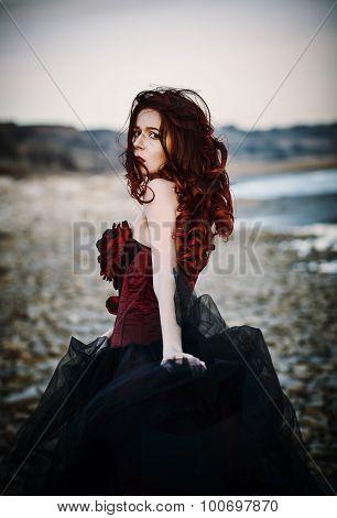 Beautiful Sad Goth Girl Standing On Sea Shore. Rear View