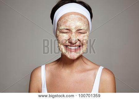 woman making facial treatment