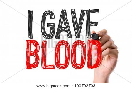 Hand with marker writing the word I Gave Blood