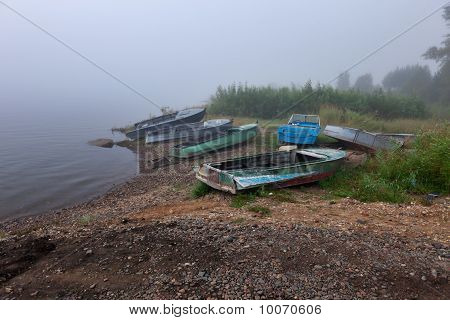 Old Boats At The Foggy Riverbank Of Siberian River Enisey