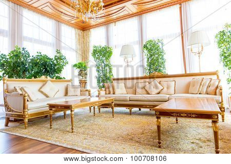 Novi Petrivtsi, Ukraine - May 27, 2015 Mezhigirya residence of ex-president of Ukraine Yanukovich. Light living room with modern furniture and plants