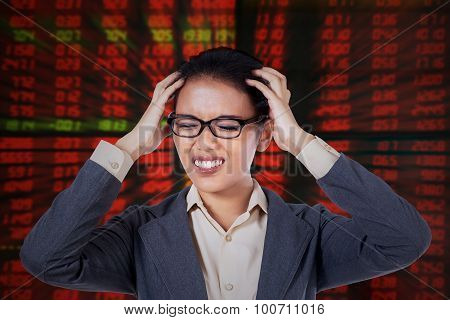 Depressed Businesswoman With Stock Market Background