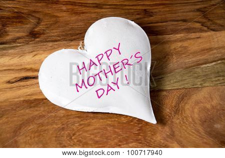 a white heart with the sample text - happy Mother`s day