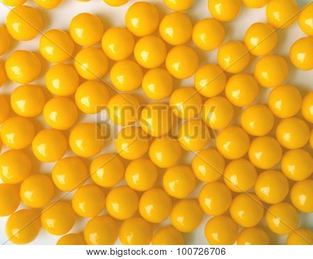 Yellow Round Pills, As Vitamins On White Background.