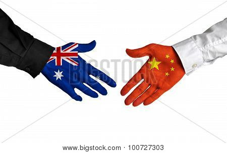 Australia and China leaders shaking hands on a deal agreement