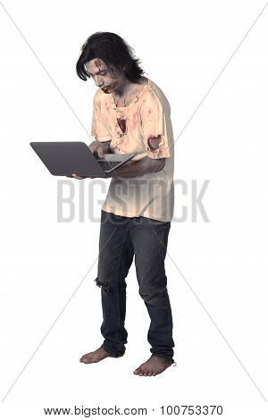 Creepy Asian Male Zombie Typing With Laptop