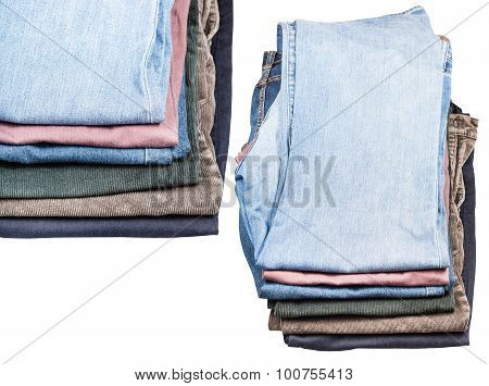Set Of Stacks Of Various Jeans And Corduroys
