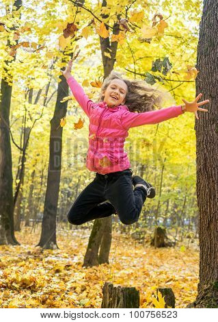 Happy Young Girl In High Jump