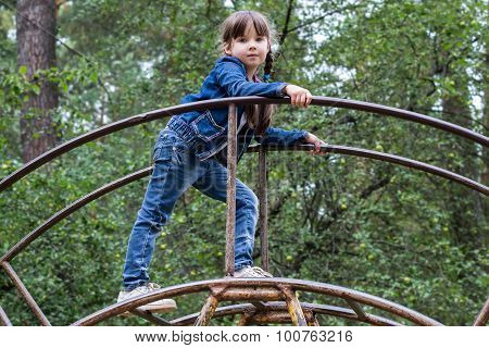 Brave Little Girl Climbed Up The Stairs In The Forest