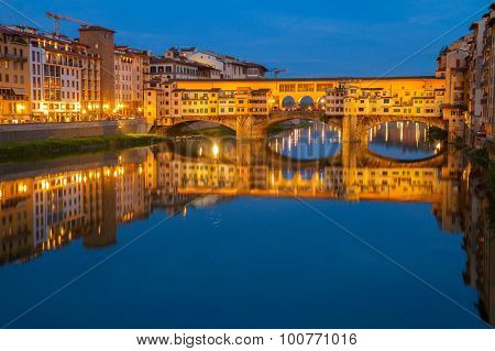 famous bridge Ponte Vecchio over river Arno at night, Florence, Italy poster