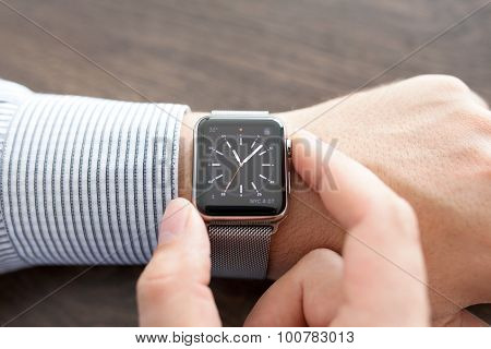 Man Hand With Apple Watch On The Desk
