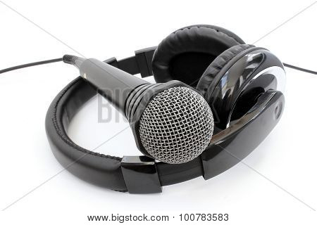 A Microphone Lying On Headphones