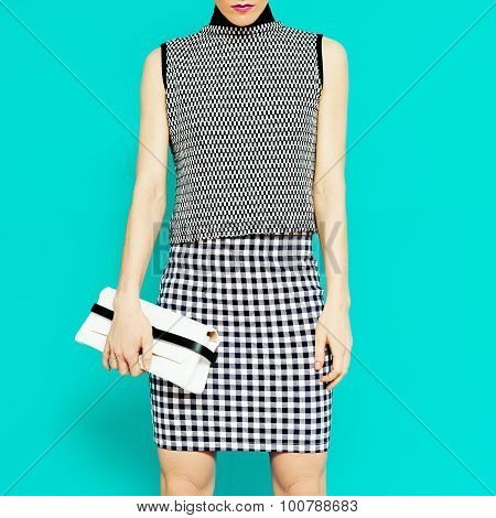 Fashion Model In Stylish Clothes.geometric Combination Of Trend