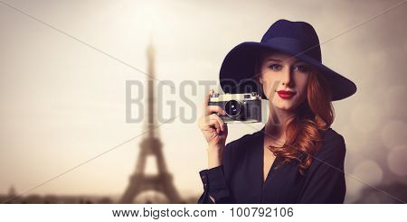 Style Redhead Women With Sunglasses And Vintage Camera.