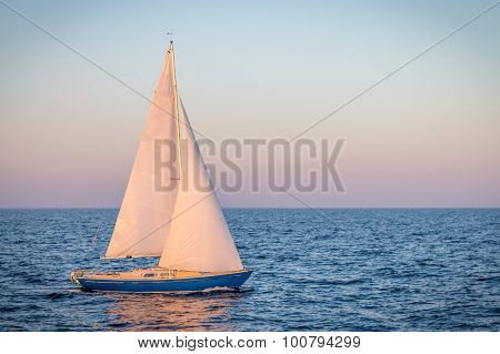 Blue Sailboat In The Ocean
