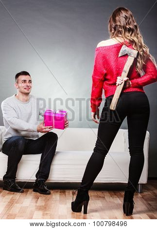Trusting Guy Giving Present To Misleading Girl