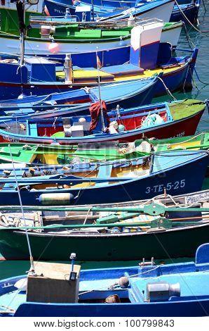 Colorful fishing boats in fishing harbor in Las Galletas on Tenerife