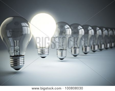 Idea or uniqueness, originality concept. Row of light bulbs with glowing one on blue background, 3d