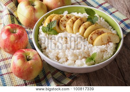 Delicious Rice Pudding With Apples And Cinnamon In A Bowl. Horizontal.