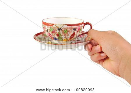 Hand with chinese cup of coffee isolated on a white background