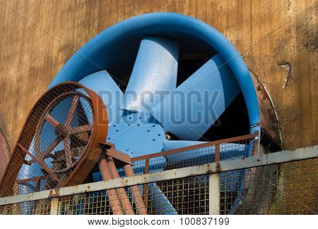 blue ventilator at the Landschaftspark Duisburg-Nord a public park in the German city of Duisburg. The centerpiece of the park is formed by the ruins of a blast furnace complex shut down in 1985.