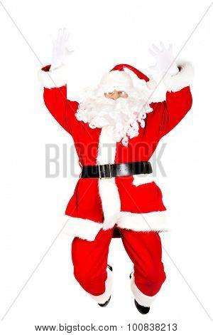 Cheerful Santa Claus jumping in air