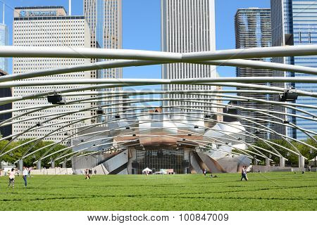 CHICAGO, ILLINOIS - AUGUST 22, 2015: Pritzker Pavilion and Great Lawn. In Chicago's Millennium Park, it is the home of the Grant Park Symphony Orchestra and Chorus and the Grant Park Music Festival.