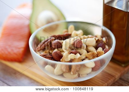 healthy eating, protein food, diet and culinary concept - close up of nut mix in glass bowl on table