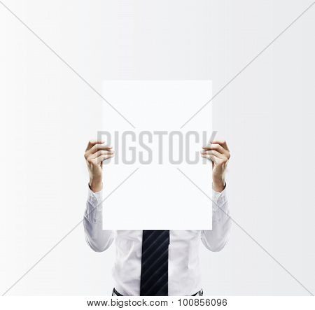 Businessman Holding Paper Card