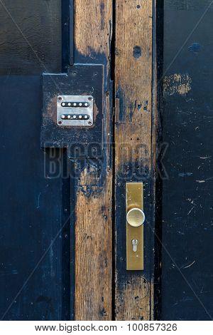 Iron Doorknob Of Wooden Door