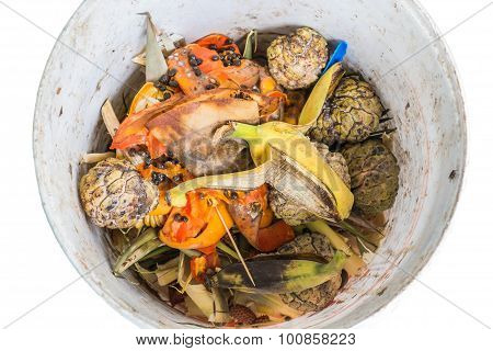 Organic waste of fruits in garbage, isolated on white background