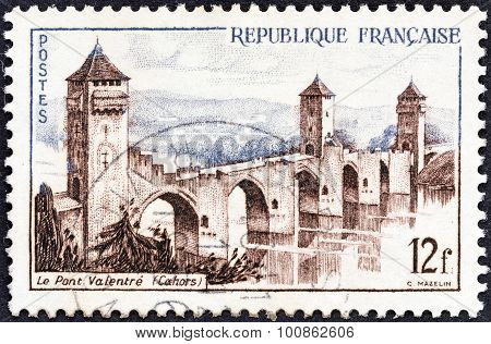 FRANCE - CIRCA 1955: A stamp printed in France shows Valentre Bridge, Cahors